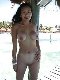 Busty shaved asian posing while on vacation